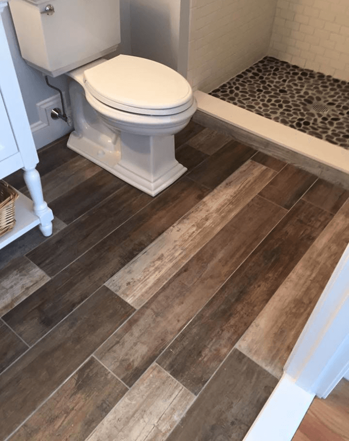 Spa like bathroom renovation wood grain tile pebble for Hardwood floors in bathroom