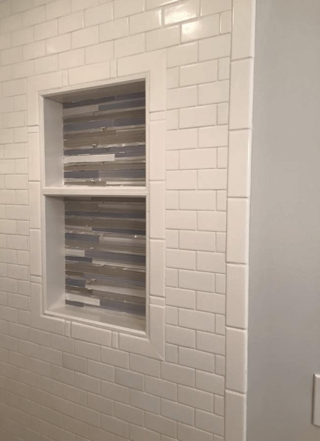 Spa-like bathroom renovation | wood-grain tile | pebble shower floor