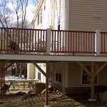 Composite and Ceadr wrap around deck in Rehobeth, Ma