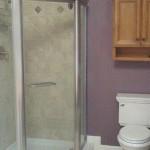 Norfolk bathroom stand up shower in Roman stone