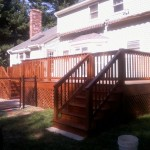 Teak stained pressure treated deck in Mansfield, Ma