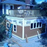 flat roof addition with new vinyl siding and roof top deck