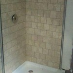 roman stone tile in stand up shower in Norfolk, Ma